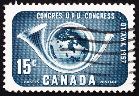 upu: CANADA - CIRCA 1957: a stamp printed in the Canada shows Post Horn and Globe, circa 1957