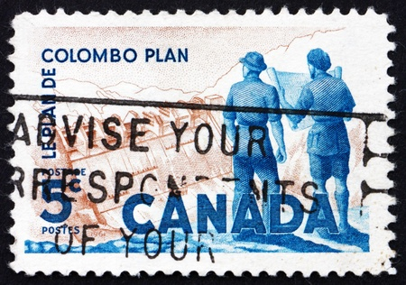 CANADA - CIRCA 1961: a stamp printed in the Canada shows Power Plant and Men Holding Blueprint, 10th Anniversary of the Colombo Plan, circa 1961