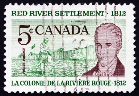 settler: CANADA - CIRCA 1962: a stamp printed in the Canada shows Scottish Settler and Lord Selkirk, 150th Anniversary of the Red River Settlement in Western Canada, circa 1962