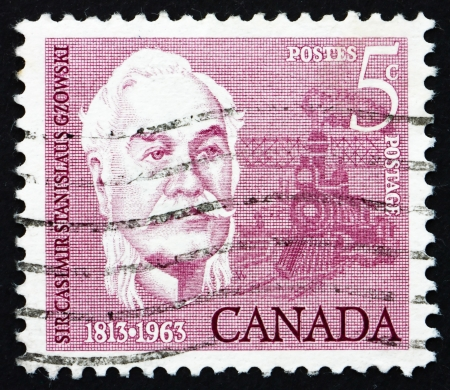 casimir: CANADA - CIRCA 1963: a stamp printed in the Canada shows Sir Casimir Stanislaus Gzowski, Engineer, Soldier and Educator, circa 1963
