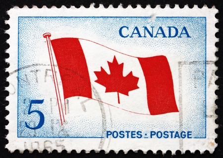 CANADA - CIRCA 1965: a stamp printed in the Canada shows Canada's Maple Leaf Flag, circa 1965 Stock Photo - 16746187