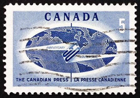 distributing: CANADA - CIRCA 1967: a stamp printed in the Canada shows Globe and Flash, 50th Anniversary of the Canadian Press, News Gathering and Distributing Service, circa 1967