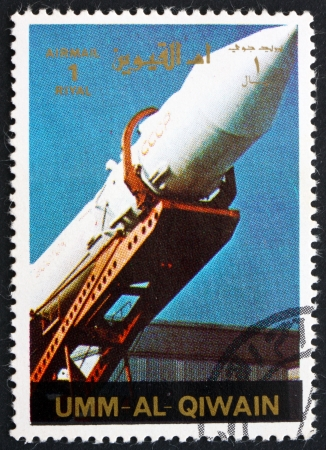 spaceflight: UMM AL-QUWAIN - CIRCA 1972: a stamp printed in the Umm al-Quwain shows A Soviet Rocket being Erected, History of Spaceflight, circa 1972 Editorial