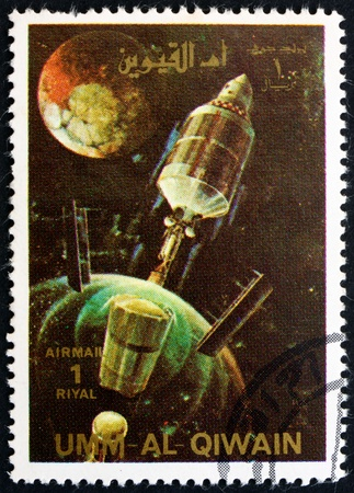 spent: UMM AL-QUWAIN - CIRCA 1972: a stamp printed in the Umm al-Quwain shows A Rocket Jettisons Spent Stages, History of Spaceflight, circa 1972