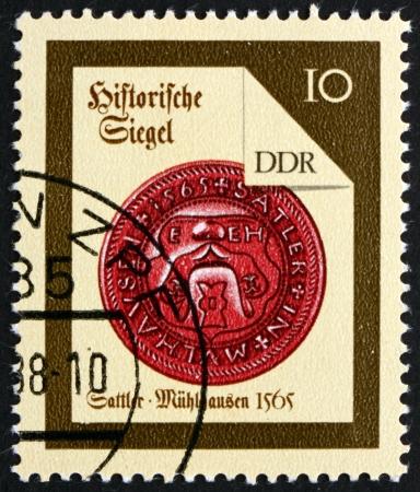 saddler: GDR - CIRCA 1988: a stamp printed in GDR shows Muhlhausen Saddler, Seal from 1565, circa 1988 Editorial