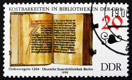 GDR - CIRCA 1990: a stamp printed in GDR shows Rules of an Order, Book from 1264, Treasures in the German State Library, Berlin, circa 1990