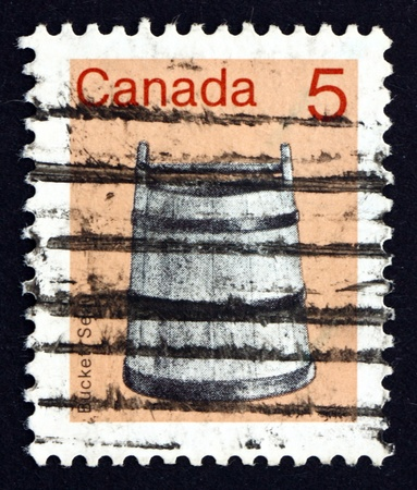 CANADA - CIRCA 1982: a stamp printed in the Canada shows Bucket, circa 1982 Stock Photo - 16746299