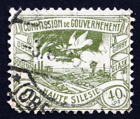 GERMANY, UPPER SILESIA - CIRCA 1920: a stamp printed in GERMANY shows Dove with Olive Branch Flying over Silesian Terrain after WWI, circa 1920