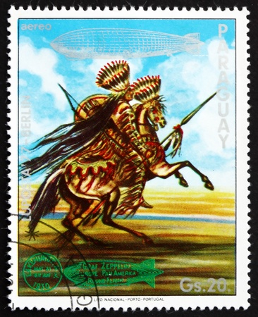 graf: PARAGUAY - CIRCA 1977: a stamp printed in Paraguay shows Indian on Horse, US, Graf Zeppelin 1st South America Flight, circa 1977