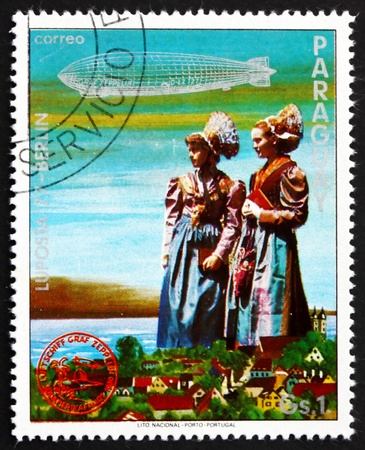 graf: PARAGUAY - CIRCA 1977: a stamp printed in Paraguay shows German Girls in Traditional Costumes, Graf Zeppelin 1st South America Flight, circa 1977