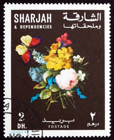 SHARJAH - CIRCA 1967: a stamp printed in the Sharjah UAE shows Bunch of Flowers and Butterfly, circa 1967