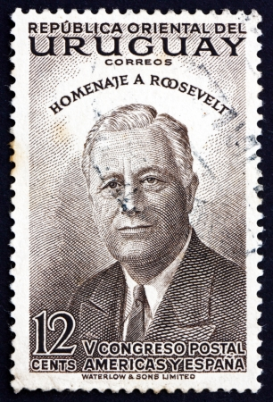 URUGUAY - CIRCA 1953: a stamp printed in the Uruguay shows Franklin Delano Roosevelt, 32nd President of the United States, circa 1953 Stock Photo - 16979300