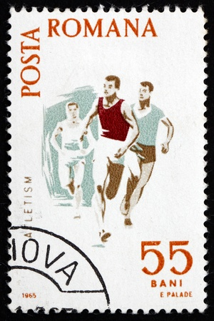 ROMANIA - CIRCA 1965: a stamp printed in the Romania shows Running, Spartacist Games, circa 1965 Stock Photo - 16994230