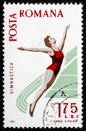 ROMANIA - CIRCA 1965: a stamp printed in the Romania shows Woman Diver, Spartacist Games, circa 1965 Stock Photo - 16994232