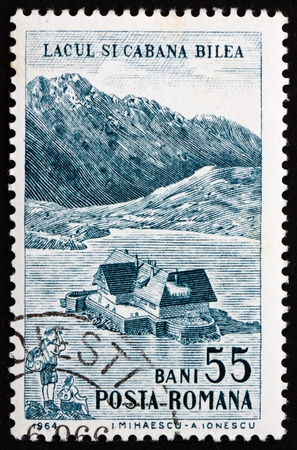 ROMANIA - CIRCA 1964: a stamp printed in the Romania shows Lake Bilea and Cottage, Tourist Publicity, circa 1964