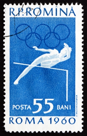 ROMANIA - CIRCA 1960: a stamp printed in the Romania shows High Jump, Athletics, Summer Olympics, Roma 60, circa 1960 Stock Photo - 17063369