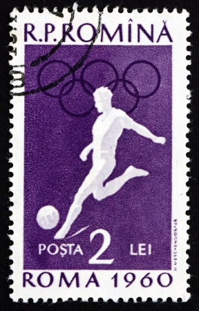 ROMANIA - CIRCA 1960: a stamp printed in the Romania shows Soccer, Summer Olympics, Roma 60, circa 1960 Stock Photo - 17063368
