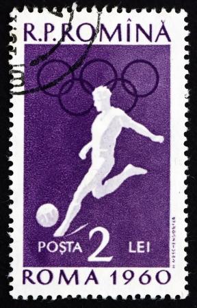 ROMANIA - CIRCA 1960: a stamp printed in the Romania shows Soccer, Summer Olympics, Roma 60, circa 1960 Stock Photo - 17063368