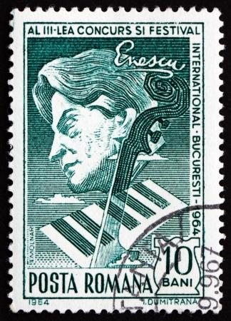 ROMANIA - CIRCA 1964: a stamp printed in the Romania shows George Enescu, Composer, Violinist, Piano Keys and Neck of Violin, circa 1964 Stock Photo - 17063391