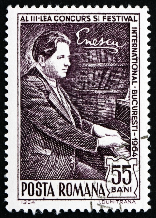 ROMANIA - CIRCA 1964: a stamp printed in the Romania shows George Enescu at Piano, Composer, circa 1964 Stock Photo - 17063410