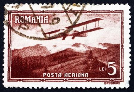 ROMANIA - CIRCA 1931: a stamp printed in the Romania shows Biplane, circa 1931 Stock Photo - 17069838