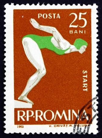 ROMANIA - CIRCA 1963: a stamp printed in the Romania shows Woman Swimmer at Start, circa 1963 Stock Photo - 17145041