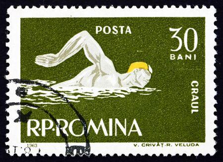 ROMANIA - CIRCA 1963: a stamp printed in the Romania shows Man Swims Crawl Style, circa 1963 Stock Photo - 17145050