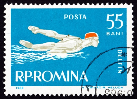 ROMANIA - CIRCA 1963: a stamp printed in the Romania shows Man Swims Butterfly Stroke Style, circa 1963 Stock Photo - 17145035