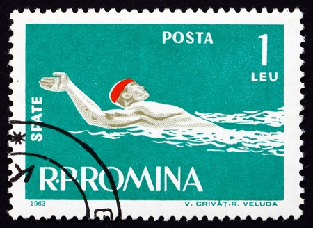 ROMANIA - CIRCA 1963: a stamp printed in the Romania shows Man Swims Backstroke Style, circa 1963 Stock Photo - 17145042