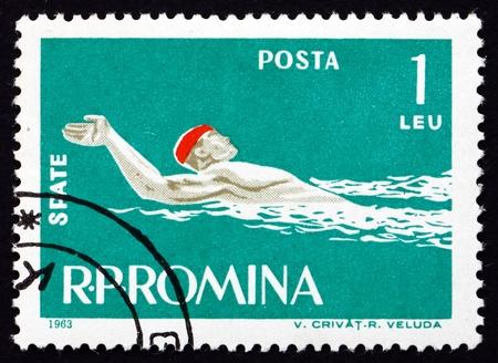 ROMANIA - CIRCA 1963: a stamp printed in the Romania shows Man Swims Backstroke Style, circa 1963 Stock Photo - 17145042