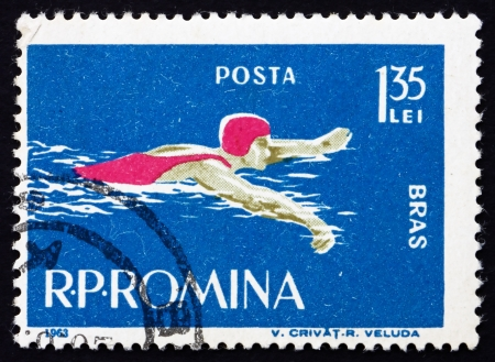 ROMANIA - CIRCA 1963: a stamp printed in the Romania shows Woman Swims Breaststroke Style, circa 1963 Stock Photo - 17145047