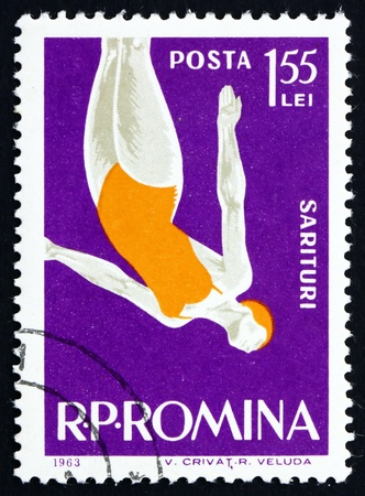 ROMANIA - CIRCA 1963: a stamp printed in the Romania shows Woman Diver, Jumping into Water from Platform, circa 1963 Stock Photo - 17145037