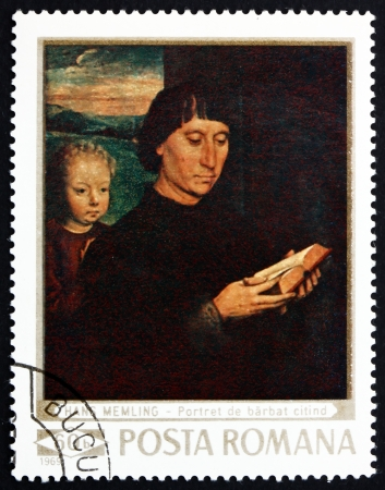 memling: ROMANIA - CIRCA 1969: a stamp printed in the Romania shows Man Reading and Child, Painting by Hans Memling, circa 1969