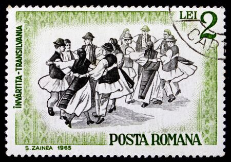 ROMANIA - CIRCA 1966: a stamp printed in the Romania shows Folk Dancers of Transylvania, Traditional Folk Dance, circa 1966