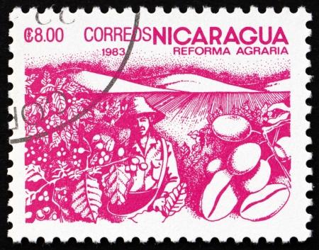 Nicaragua: NICARAGUA - CIRCA 1983: a stamp printed in Nicaragua shows Coffee Beans, Agrarian Reform, circa 1983 Editorial