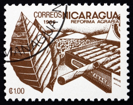 agrarian: NICARAGUA - CIRCA 1986: a stamp printed in Nicaragua shows Tobacco, Agrarian Reform, circa 1986 Editorial