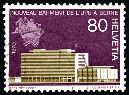SWITZERLAND - CIRCA 1970: a stamp printed in the Switzerland shows Building of New UPU Headquarters in Bern, circa 1970 Stock Photo - 17268795