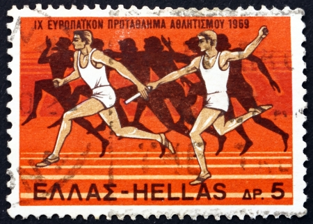 GREECE - CIRCA 1969: a stamp printed in the Greece shows Relay Race and Runners from Amphora, 525 B.C., 9th European Athletic Championships, Athens, circa 1969 Stock Photo - 17268785
