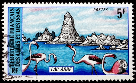 abe: AFARS AND ISSAS - CIRCA 1974: a stamp printed in Afars and Issas shows Flamingos and View of Lake Abe, circa 1974
