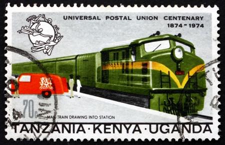 TANZANIA, KENYA, UGANDA - CIRCA 1974: a stamp printed in the Tanzania shows Mail Train and Truck, circa 1974 Stock Photo - 17392540