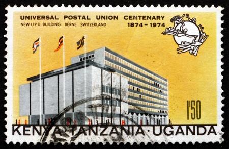 upu: TANZANIA, KENYA, UGANDA - CIRCA 1974: a stamp printed in the Tanzania shows UPU Headquarters, Bern, Universal Postal Union, circa 1974