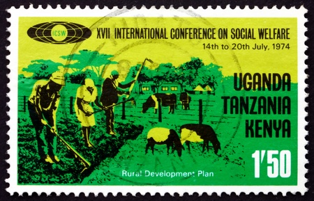 TANZANIA, KENYA, UGANDA - CIRCA 1974: a stamp printed in the Tanzania shows Family Hoeing and Livestock, Social Welfare, circa 1974 Stock Photo - 17392538