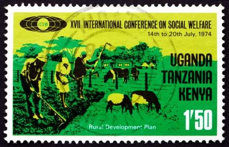 hoeing: TANZANIA, KENYA, UGANDA - CIRCA 1974: a stamp printed in the Tanzania shows Family Hoeing and Livestock, Social Welfare, circa 1974