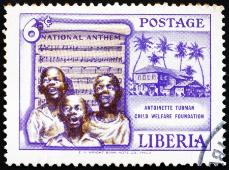 anthem: LIBERIA - CIRCA 1957: a stamp printed in the Liberia shows Singing Boys and National Anthem, Founding of the Antoinette Tubman Child Welfare Foundation, circa 1957