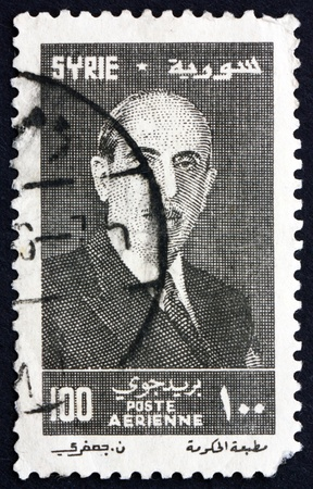 SYRIA - CIRCA 1956: a stamp printed in the Syria shows Shukri el Kouatly, President of the Syria, circa 1956 Stock Photo - 17393050