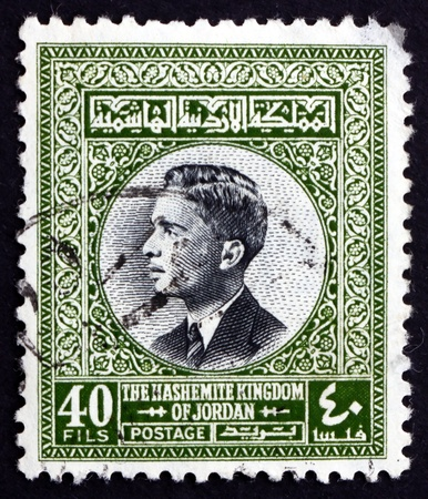 king hussein: JORDAN - CIRCA 1959: a stamp printed in the Jordan shows King Hussein, King of Jordan, circa 1959 Editorial
