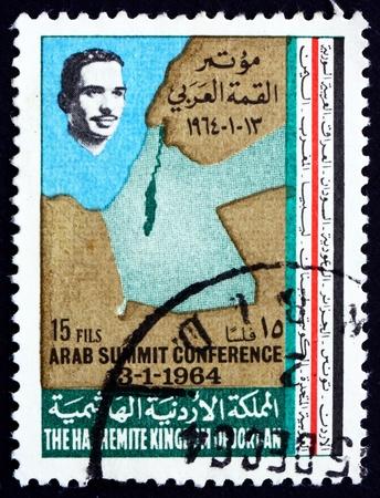 king hussein: JORDAN - CIRCA 1964: a stamp printed in the Jordan shows King Hussein and Map of Jordan and Israel, circa 1964