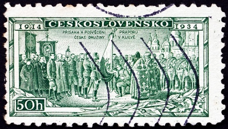 CZECHOSLOVAKIA - CIRCA 1934: a stamp printed in the Czechoslovakia shows Consecration of Legion Colors at Kiev, 20th Anniversary of Legion which Fought in WWI, circa 1934 Stock Photo - 17523404