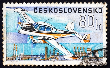 aero: CZECHOSLOVAKIA - CIRCA 1967: a stamp printed in the Czechoslovakia shows Aero Taxi L-200, Airplane, circa 1967 Editorial