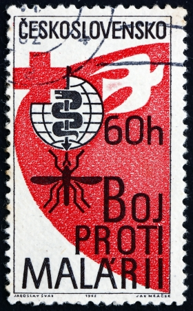 CZECHOSLOVAKIA - CIRCA 1962: a stamp printed in the Czechoslovakia shows Malaria Eradication Emblem, Cross and Dove, WHO Drive to Eradicate Malaria, circa 1962 Stock Photo - 17523431
